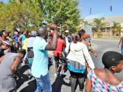 Wallacedene residents who were evicted from a piece of land protest in front of the Kraaifontein Police Station. Photo: Henk Kruger
