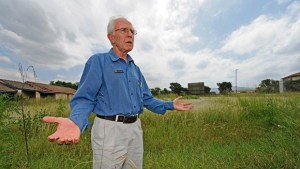 Scottsville Primary School principal Bobby Nefdt stands at the vacant Bowling Club land opposite the school that he says the school needs for sports and aftercare facilities. (Ian Carbutt, The Witness)