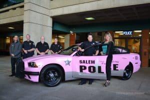 Salem Police Foundation Members pose with the Salem Police Department pink patrol car