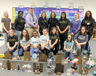 Andrew Lewis Middle School Principal James Garst, Teacher Sarah Gerrol, First Lady Pam Northam and Teacher Sonya Preston, back row left to right, and several members of the Girls Who Code organization.