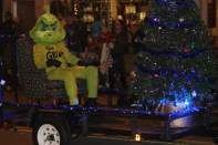 The Grinch greeting attendees.