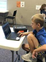 Young student learning virtually from the Y Enrichment Center.