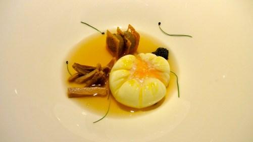 Their Signature Dish: Poached Egg, Shredded Chicken, Liver Pâté, and Caviar.