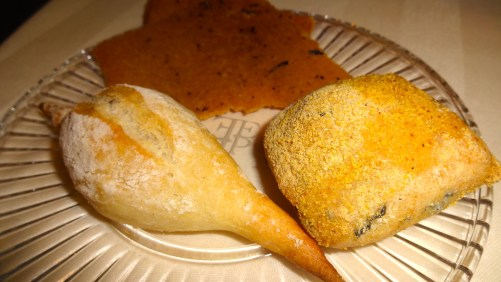 Black Cabbage Roll, Mini Baguette, and Polenta Crisps.