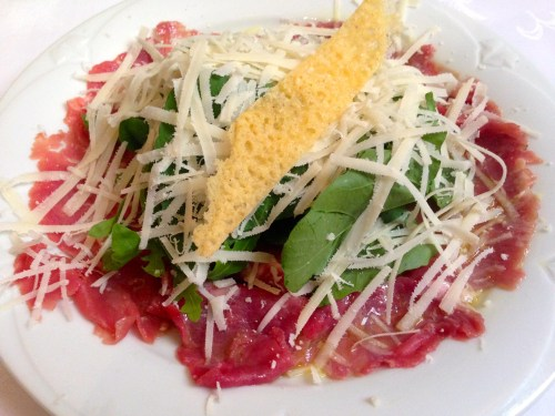 Beef Carpaccio with Arugula and Parmigiano Reggiano Cheese.