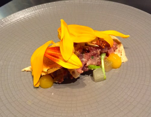 Lamb Tartare with Asian Pear, Kohlrabi, Sunchoke Chips, Egg Yolk Fudge, and Sunflower Sprouts and Petals.