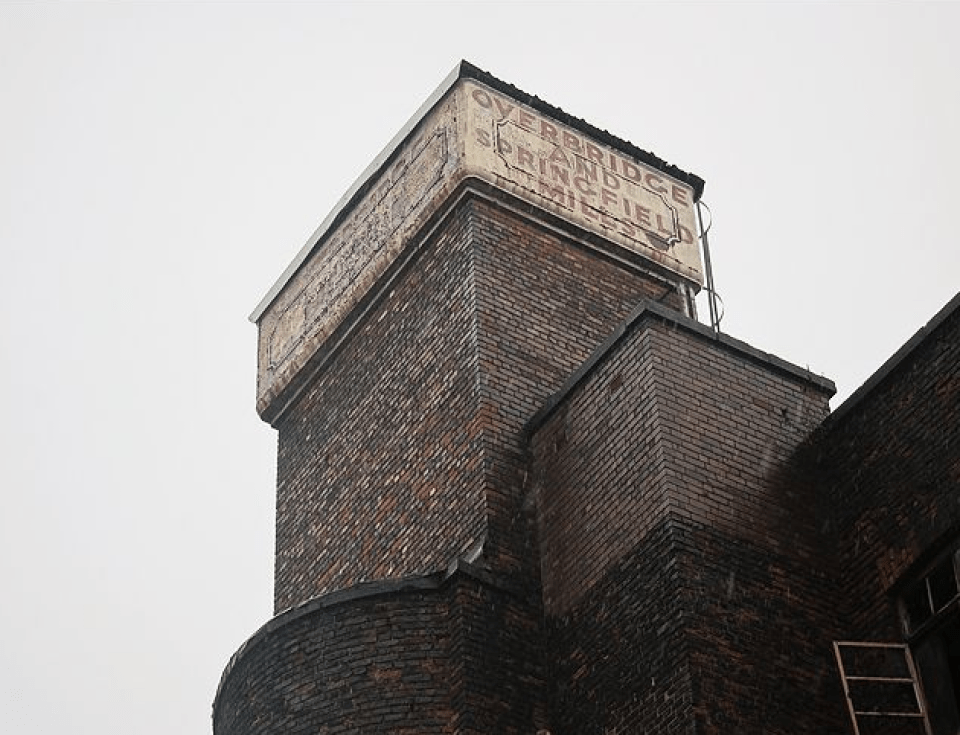 The water tower, the only part of the building left - Michael Johnson/Historic England