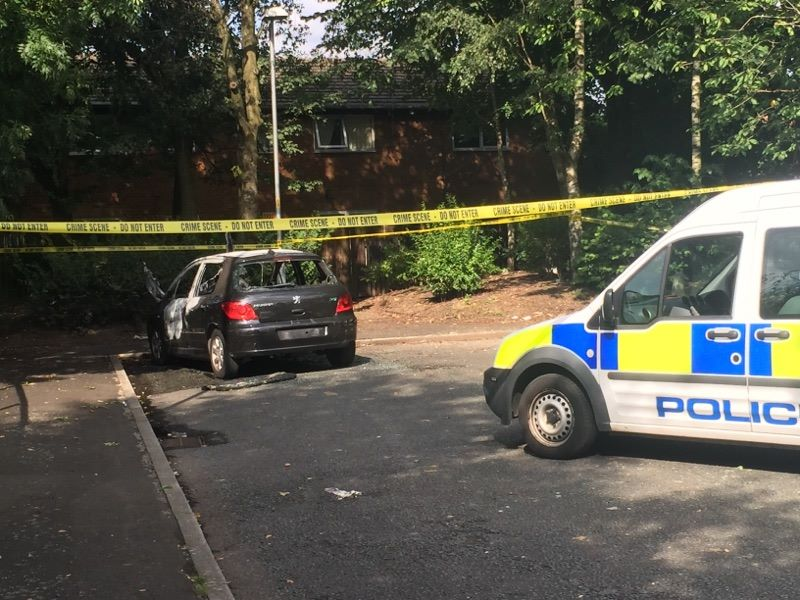 The getaway car was dumped and burned out on a nearby housing estate