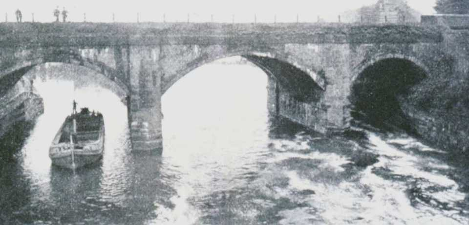 A barge passes under the original Barton Aqueduct © Salford Local History Library
