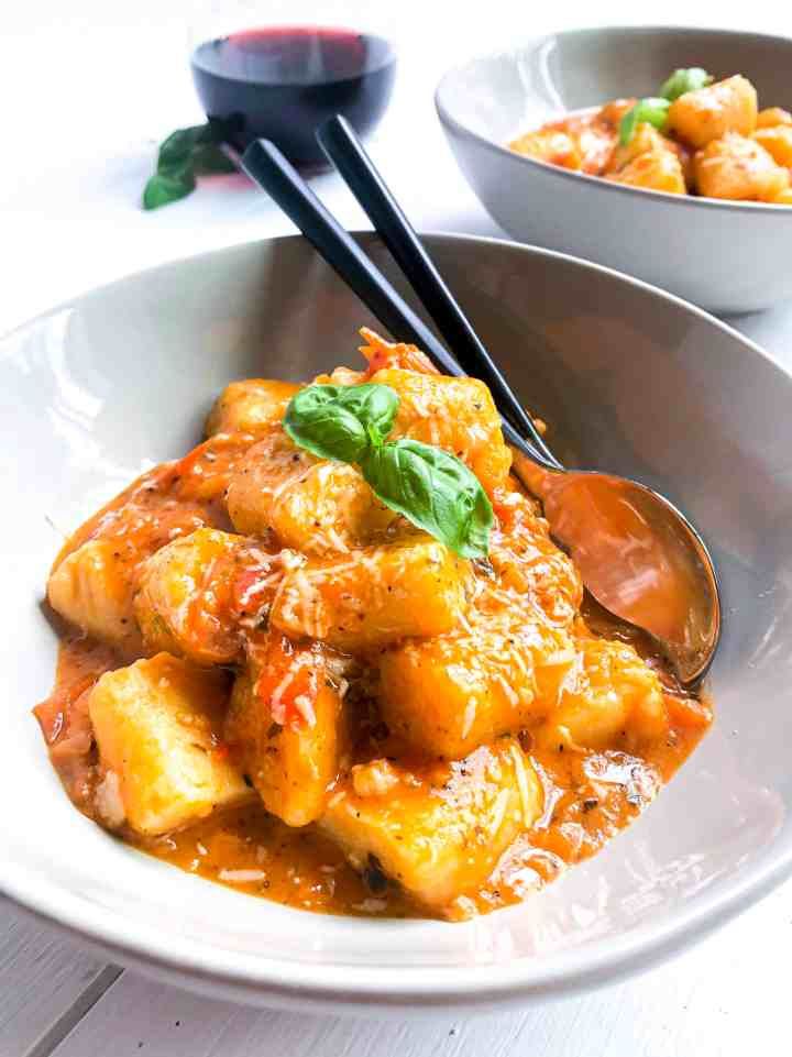 Two bowls of gluten free gnocchi.