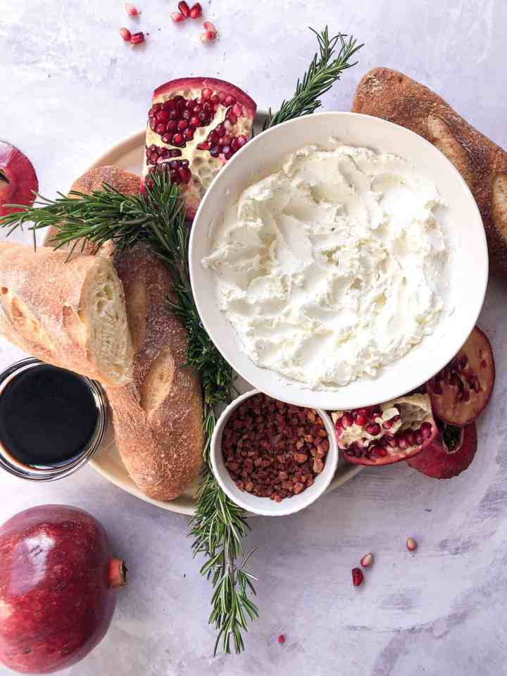 Ingredients for goat cheese pomegranate crostini.