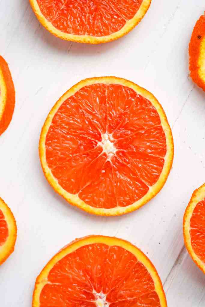 A table of thinly sliced oranges.