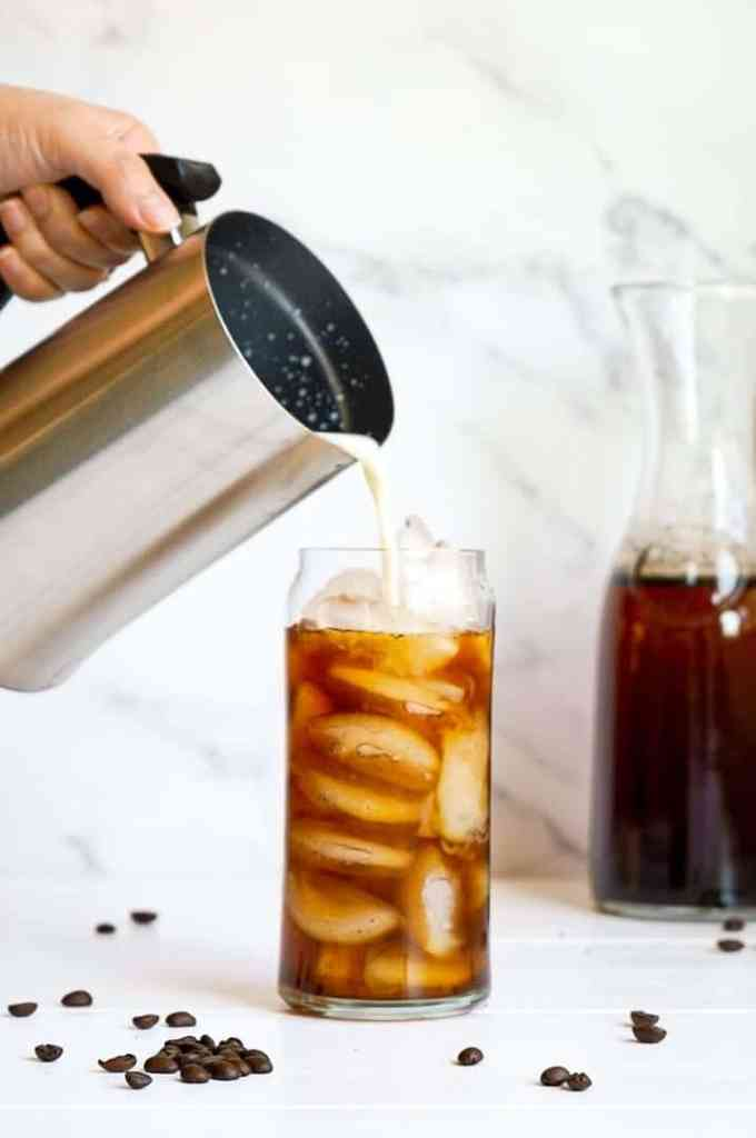 A French press pouring Overnight Cold Brew Coffee.