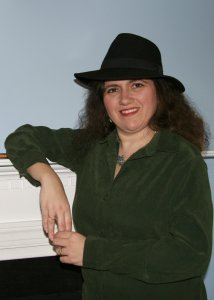 A nice photo of Karina Fabian wearing a black hat.