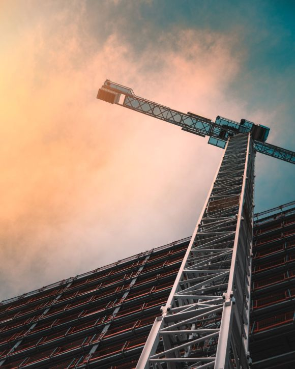 Photo by James Sullivan on Unsplash high rise construction crane