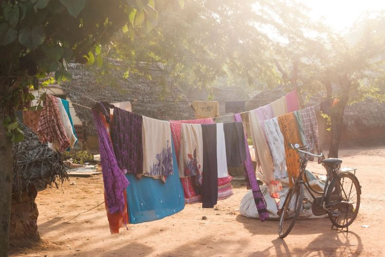 Photo by Matthew T Rader on Unsplash laundry on a line with a bike