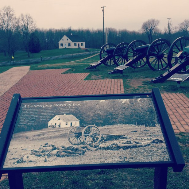 Antietam National Battlefield. The photo in the foreground contains the house standing beyond the canons.