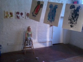 artwork in gallery; young blonde child