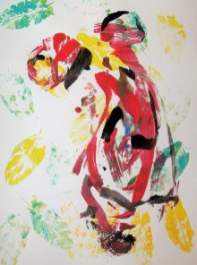outline of woman covered by multi-colored prints