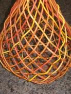 close up dyed cane plaited basket