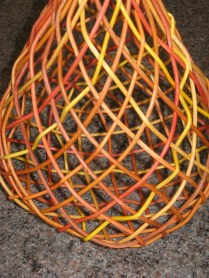 close up dyed cane plaited basket
