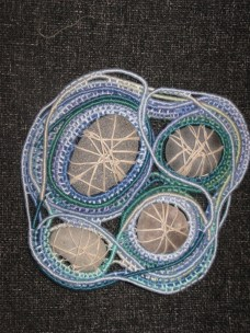 pebbles coiled with embroidery thread and paper string