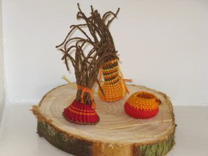 series of miniature coiled and twined baskets