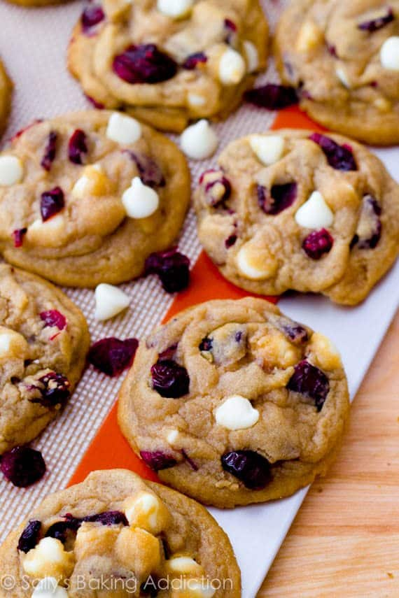 Soft-baked White Chocolate Cranberry Cookies using a secret ingredient to make them super soft. Recipe by sallysbakingaddiction.com