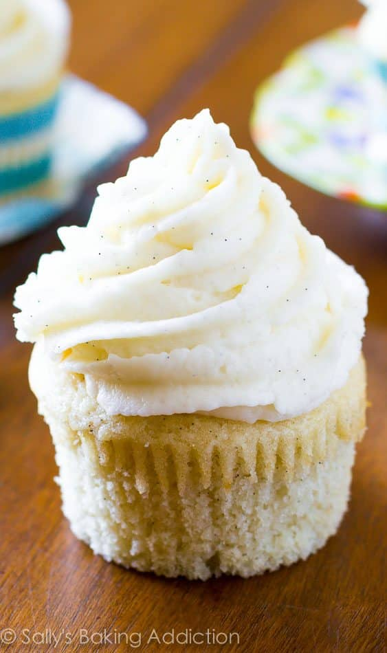 The BEST homemade vanilla cupcakes. Easy to make and full of rich, buttery vanilla flavor. Recipe by @sallybakeblog