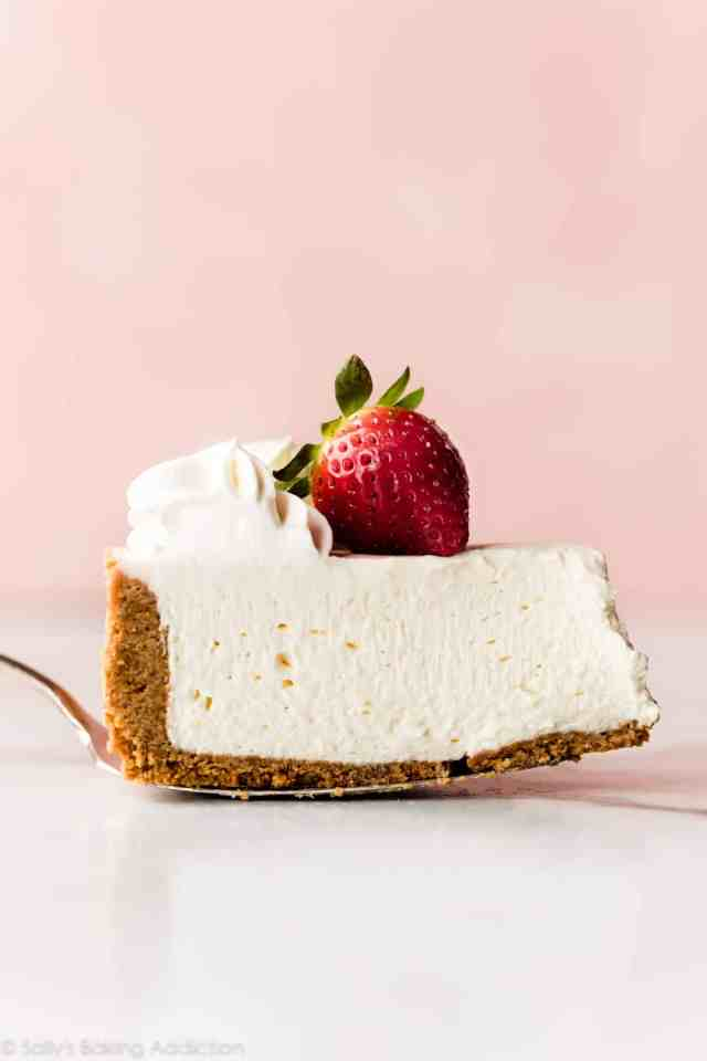 Slice Of No Bake Cheesecake With A Strawberry On Top