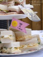 Egg and cress sandwiches on vintage cake stand afternoon tea for hen do