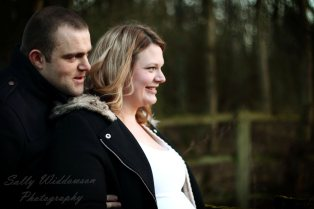 Happy pregnant couple in profile for couples photography session