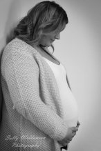 Pregnant lady profile hands on bump black and white maternity photography looking at bump