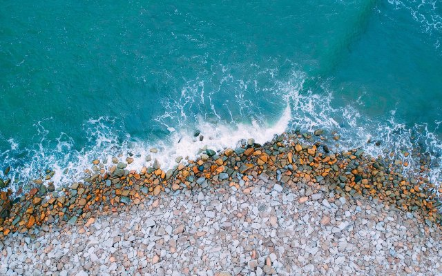 An aerial shot of beach with bird's eye view. Free stock photo by Pexels.