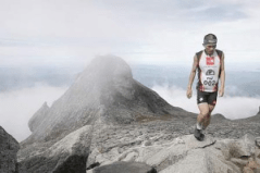 No mountain high enough: Malaysian participant Safrey Sumping reaching the top of Mount Kinabalu to clinch the fourth place in the Mount Kinabalu International Climbathon