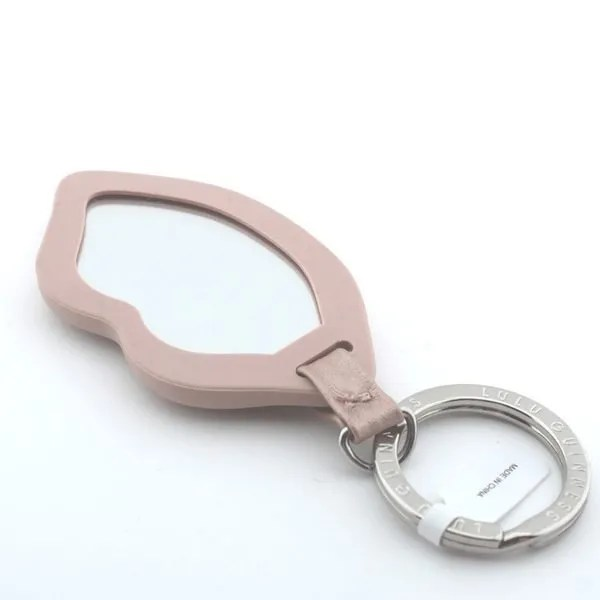 his Lulu Guinness Lips Mirror Keyring was created in partnership with GHD in support of Breast Cancer Now.