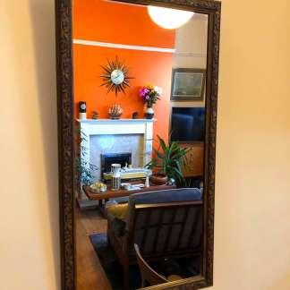 ornate wooden framed mirror