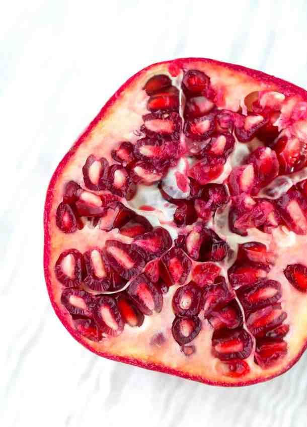 Close up of a pomegranate cut in half.
