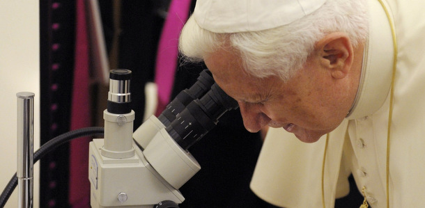 Pope Benedict XVI looking down a microscope - because a believer can also explore science!