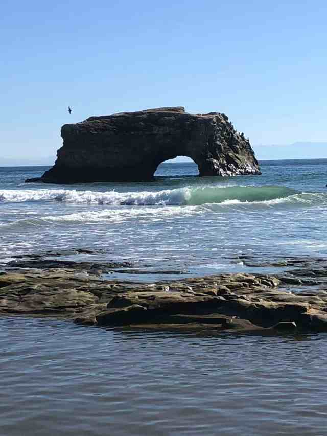 arched rock in the ocean