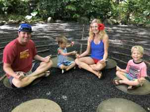 A family sitting in a maze in Maui