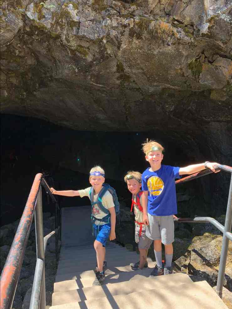 Three boys with head lamps about to enter into the Subway cave near Lassen National Park