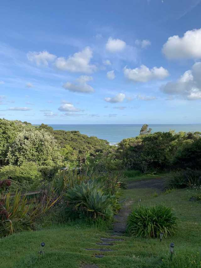 the view of the ocean and the surf break from an airbnb in raglan