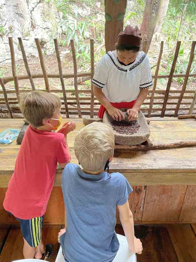 kids watching a chocolate making class in belize