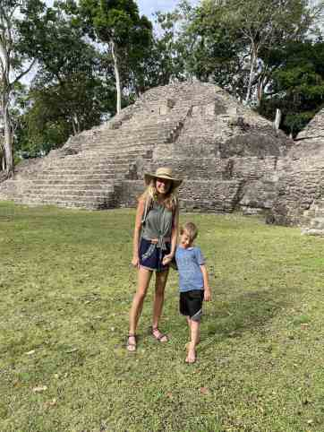 mom and son standing by a mayan ruin in Belize