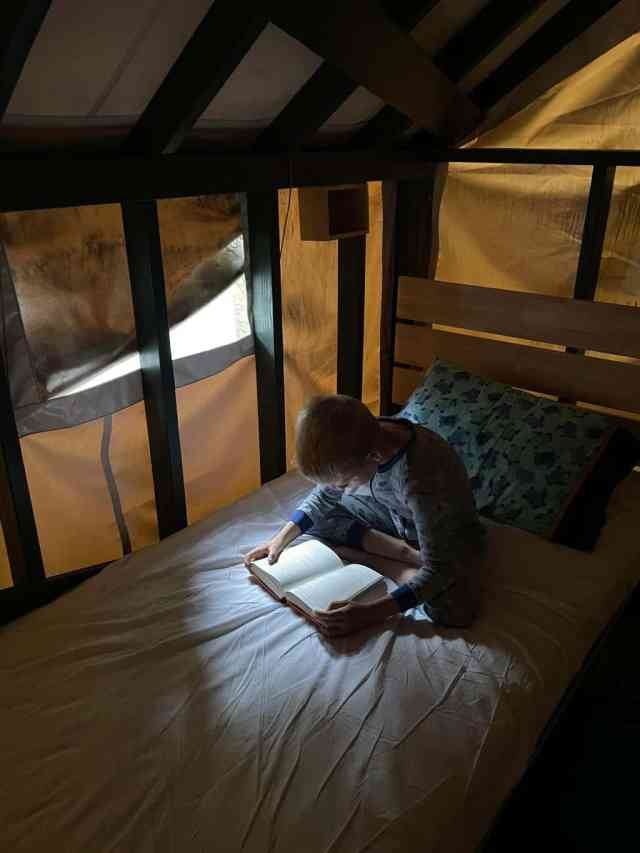 reading in a tent cabin at curry village