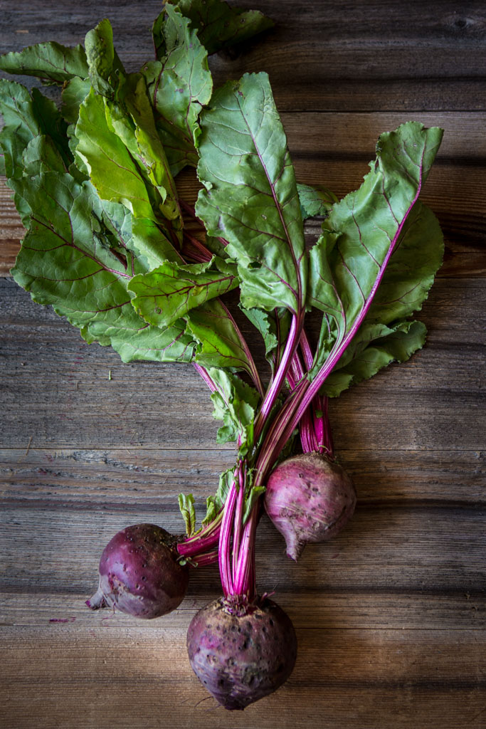 Bunch of three beets on wooden table