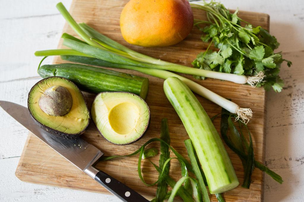 mango, avocado cucumber, cilantro, scallions on cutting board
