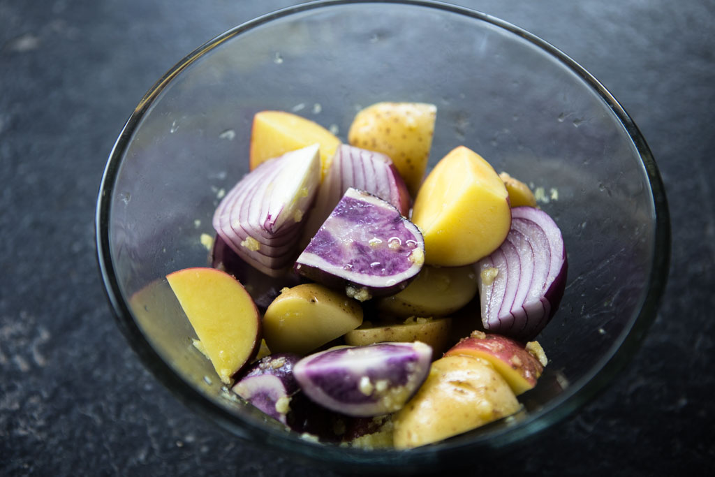 Potatoes tossed in olive oil, garlic and salt - oven-ready.