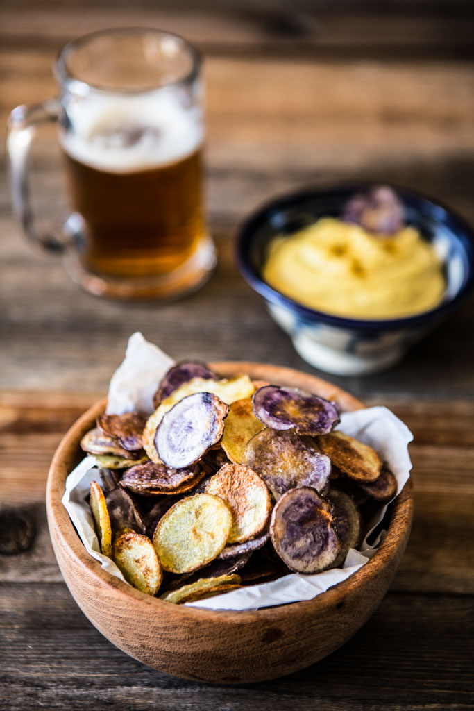 Oven-baked potato chips made with purple and waxy potatoes.
